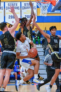 Gaithersburg's Jordan Graham drives the center of the lane surrounded by Richard Montgomery players.   Graham forced a foul and picked up 2 points at the line.  Gaithersburg vs Richard Montgomery Boys Varsity Basketball Photo Credit:  David Wolfe