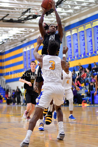Gaithersburg's Kevin Neal tries to block Richard Montgomey's Daryn Alexander from scoring.  Gaithersburg vs Richard Montgomery Boys Varsity Basketball Photo Credit:  David Wolfe