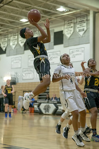 Williams of Richard Montgomery sores for an easy 2nd half basket as RM pulls away from  Northwest. PHOTO BY MIKE CLARK