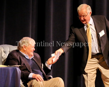 """George P. Smith/The Montgomery Sentinel    In a moment of levity, long time friend Tom Crowell hands Bob Milloy the perverbial """"check"""" during the Roast & Toast of Coach Bob Milloy held at Our Lady of Good Counsel High School's Performing Arts Center on Saturday, February 10, 2018."""