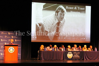 George P. Smith/The Montgomery Sentinel    Master of Ceremonies Johnny Holliday (on left) and the Speakers on stage for the Roast & Toast of Coach Bob Milloy held at Our Lady of Good Counsel High School's Performing Arts Center on Saturday, February 10, 2018.