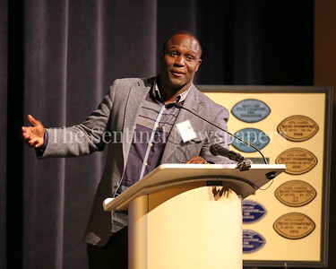 George P. Smith/The Montgomery Sentinel    Springbrook graduate Shawn Springs, one of 8 player coached by Bob Milloy to play in the NFL, speaks at the Roast & Toast of Coach Bob Milloy held at Our Lady of Good Counsel High School's Performing Arts Center on Saturday, February 10, 2018.