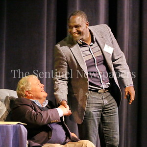 George P. Smith/The Montgomery Sentinel    Springbrook graduate Shawn Springs, one of 8 player coached by Bob Milloy to play in the NFL, greets his coach at the Roast & Toast of Coach Bob Milloy held at Our Lady of Good Counsel High School's Performing Arts Center on Saturday, February 10, 2018.