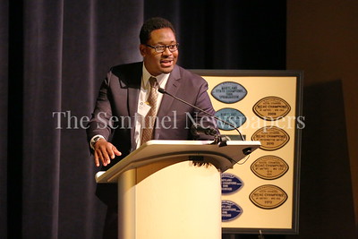 George P. Smith/The Montgomery Sentinel    Our Lady of Good Counsel High School '06 graduate Akeem Hebron spoke at the Roast & Toast of Coach Bob Milloy held at Our Lady of Good Counsel High School's Performing Arts Center on Saturday, February 10, 2018.
