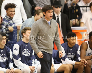 George P. Smith/The Montgomery Sentinel    Georgetown Preparatory School varsity boys basketball head coach Ryan Eskow remains intense despite his team having a comfortable lead over Bullis in the game played Thursday, January 11, 2018 at Prep.