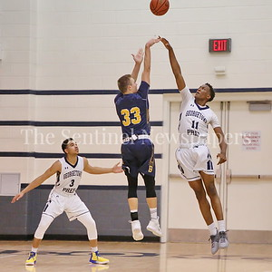 George P. Smith/The Montgomery Sentinel   Bullis' Lincoln Yeutter (#33) shoots over Georgetown Preparatory School's Dejean Desire (#11) as Milton Bynum (#3) looks on in the game played Thursday, January 11, 2018 at Prep.