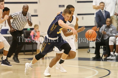 George P. Smith/The Montgomery Sentinel   Bullis' Lincoln Yeutter (#33) pushes the ball down court during the transition as   Georgetown Preparatory School's Dylan Thompson (#22) gives chase in the game played Thursday, January 11, 2018 at Prep.