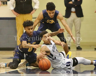 "George P. Smith/The Montgomery Sentinel    Bullis'  Frevado ""Vado"" Morse (#0) and Georgetown Preparatory School's Milton Bynum (#3) scramble for a loose ball in the game played Thursday, January 11, 2018 at Prep."