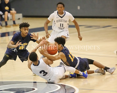 George P. Smith/The Montgomery Sentinel    Georgetown Preparatory School's Milton Bynum (#3) and Bullis' Phillip Smith (#11) chase after a loose ball in the game played Thursday, January 11, 2018 at Prep.