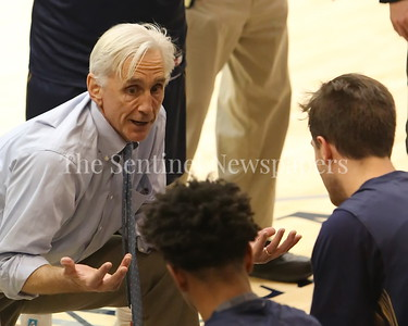 George P. Smith/The Montgomery Sentinel    Bullis head coach Bruce Kelly, in his 14th season, tries to rally the troops as they trail  Georgetown Preparatory School in the game played Thursday, January 11, 2018 at Prep.