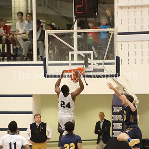 George P. Smith/The Montgomery Sentinel    Kids in the gallery have a birdseye view of this dunk by Georgetown Preparatory School's Ike Nweke (#24) in the game played Thursday, January 11, 2018 at Prep.