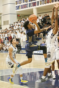 "George P. Smith/The Montgomery Sentinel     Bullis'  Frevado ""Vado"" Morse (#0)  drives on Georgetown Preparatory School's Ike Nweke (#24) in the game played Thursday, January 11, 2018 at Prep."