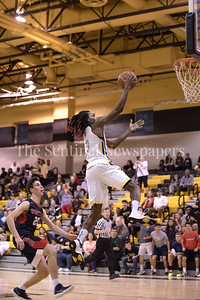 Daryn Alexander of Richard Montgomery picks up an easy bucket and finished the night with 23-points against Wootton. PHOTO BY MIKE CLARK