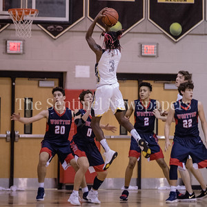 Daryn Alexander of Richard Montgomery raises up for 2 of his 23 points against the swarming Wootton defense. PHOTO BY MIKE CLARK