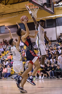 Wootton's True Johnson drives in on the Richard Montgomery defense for the layup. PHOTO BY MIKE CLARK