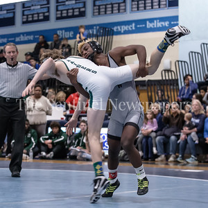 Yonas Harris of Northwest wins the 106lb weight class championship with a 8-3 decision over Drew Pruett of Atholton. PHOTO BY MIKE CLARK
