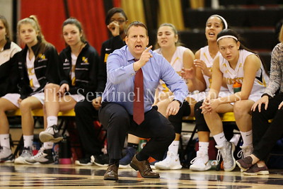 George P. Smith/The Montgomery Sentinel    Richard Montgomery High School girls varsity head basketball coach Mike Oakes maintains the intensity off the bench as his team leas Quince Orchard High School in the game played Friday, January 19, 2018.