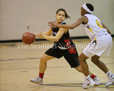 George P. Smith/The Montgomery Sentinel    Quince Orchard High School's Makayla Wright (#10) drives past Richard Montgomery High School's Karon Williams (#4) in the game played at Richard Montgomery on Friday, January 19, 2018.