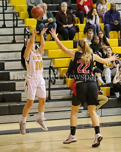 George P. Smith/The Montgomery Sentinel    Richard Montgomery High School's Deedee Yan (#10) shoots from beyond the arc over Quince Orchard High School's Jenna Williams (#22) in the game played Friday, January 19, 2018.