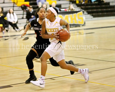 George P. Smith/The Montgomery Sentinel    Richard Montgomery High School's Karon Williams (#4) takes it to the hoop past Quince Orchard High School's Anaya Badmus (#3) in the game played Friday, January 19, 2018.