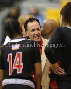 George P. Smith/The Montgomery Sentinel    Quince Orchard High School girls varsity head basketball coach Chris Campbell tries to rally his players as they trailed Richard Montgomery High School in the game played Friday, January 19, 2018.