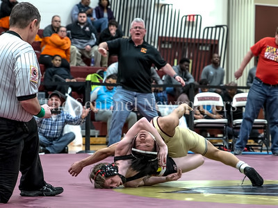Brian  Trinh of Paint Branch is caught in the grasp of Jesse Fresh of Mountain Ridge but holds on for a 6-4 decision in the 106-lb weight class. PHOTO BY MIKE CLARK