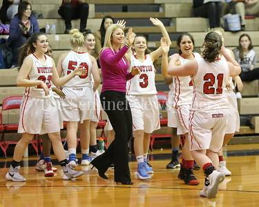 George P. Smith/The Montgomery Sentinel    Wootton High School head coach Maggie McDermott Dyer and her players congratulate Crystal Bridge (#21) after she hit a jumper at the buzzer to narrow the score to 41-39 as they headed to the locker room for halftime.