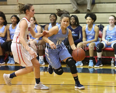 George P. Smith/The Montgomery Sentinel    Clarksburg High School's Miki Howson (#10) turns the corner on Wootton's Zoey Goldberg (#5) in the game played on the Patriot's home court on January 29, 2018.