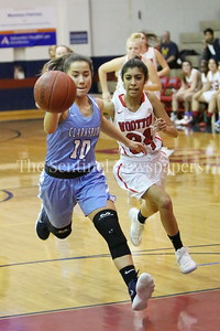 George P. Smith/The Montgomery Sentinel    Clarksburg High School's Miki Howson (#10) chases down an outlet pass as Wootton's Aliya Rahman (#24) gives chase in the game played on the Patriot's home court on January 29, 2018.