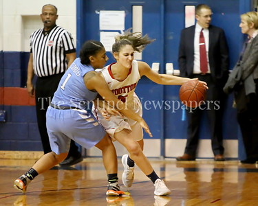 George P. Smith/The Montgomery Sentinel    Clarksburg High School's Trinity Wright (#1) reaches in as Wootton High School's  Zoey Goldberg (#5) starts the transition upcourt in the game played on the Patriot's home court on January 29, 2018.