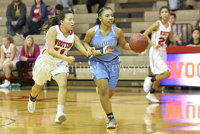George P. Smith/The Montgomery Sentinel    Wootton High School's  Katie Gillick (#11) reaches in as Clarksburg High School's Trinity Wright (#1) brings the ball up in the game played on the Patriot's home court on January 29, 2018.