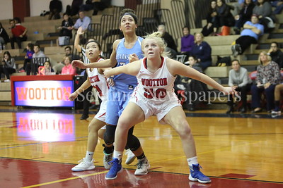 George P. Smith/The Montgomery Sentinel    Wooton High School's Mary Quackenbush (#50) and Katie Gillick (#11) box out Clarksburg's Trinity Klock (#34) under  the boards in the game played on the Patriot's home court on January 29, 2018.
