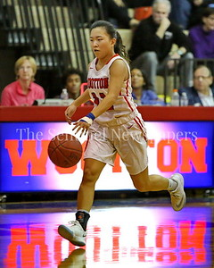 George P. Smith/The Montgomery Sentinel    Wootton High School's  Katie Gillick (#11) brings the ball downcourt on the Patriot's home court in the game against Clarksburg played on January 29, 2018.