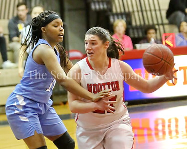 George P. Smith/The Montgomery Sentinel    Wootton High School's Crystal Bridge (#21) works to get past Clarksburg's Kimora Bowles (#14) in the game played on the Patriot's home court on January 29, 2018.