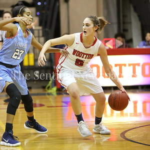 George P. Smith/The Montgomery Sentinel    Wootton High School's Zoey Goldberg (#5) works against Clarksburg High School's Phylicia McInnis (#23) n the game played on the Patriot's home court on January 29, 2018.