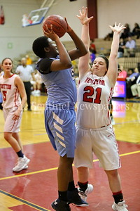 George P. Smith/The Montgomery Sentinel    Clarksburg High School's Destini Chesley (#5) shoots over Wooton High School's Crystal Bridge (#21) in the game played on the Patriot's home court on January 29, 2018.