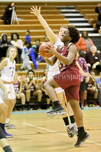 George P. Smith/The Montgomery Sentinel    Paint Branch High School's Patricia Anumgba (#24) takes it to the hoop past Walt Whitman High School's Leia Till (#23) in the game on the Lady Vikings home court Friday, February 2, 2018.