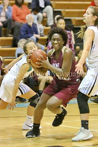 George P. Smith/The Montgomery Sentinel    Paint Branch High School's Patricia Anumgba (#24) splits the Walt Whitman High School defense on the way to the hoop in the game on the Lady Vikings home court Friday, February 2, 2018.