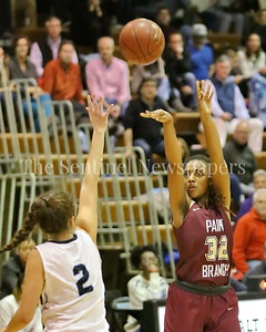 George P. Smith/The Montgomery Sentinel    Paint Branch High School's Jabria Bruce (#32) shoots over Walt Whitman High School's Sophie DeBettencourt (#2) during the game against Whitman on the Lady Vikings home court Friday, February 2, 2018.