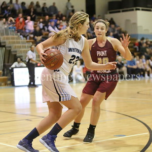 George P. Smith/The Montgomery Sentinel    Walt Whitman High School's Leia Till (#23) brings the ball upcourt against Paint Branch High School's Cynthia Srewart (#20) in the game on the Lady Vikings home court Friday, February 2, 2018.