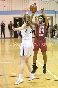 George P. Smith/The Montgomery Sentinel    Paint Branch High School's Patricia Anumgba (#24) scores from beyond the arc over Walt Whitman High School's Carter McGloon (#22) in the game on the Lady Vikings home court Friday, February 2, 2018.