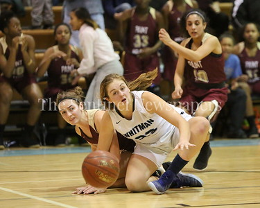George P. Smith/The Montgomery Sentinel    Paint Branch High School's Cynthia Srewart (#20) and Walt Whitman High School's Leia Till (#23) battle over a loose ball in the game on the Lady Vikings home court Friday, February 2, 2018.