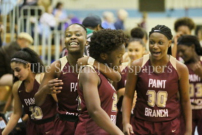 George P. Smith/The Montgomery Sentinel    Paint Branch High School's Obriani Remy (#1) hugs a still intense Patricia Anumgba (#24) after Anumgba almost single-handedly brought the Panthers back from a 14 point 4th quarter deficit with 3s, layups, and clutch free throws to win over Walt Whitman High School by a score of 74-65 on the Lady Vikings home court Friday, February 2, 2018. Whitman failed to score in the last 1:51 while Pain Branch scored 12 unanswered points. Pant Branch went on a 27 to 6 point run in the last 5:45 of the game.