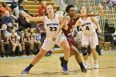 George P. Smith/The Montgomery Sentinel    Walt Whitman High School's Leia Till (#23) and Brooke Gumataotao (#4) battle Paint Branch High School's Precious Oyinloye (#40) under the boards in the game on the Lady Vikings home court Friday, February 2, 2018.