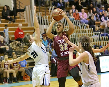 George P. Smith/The Montgomery Sentinel    Paint Branch High School's Jabria Bruce (#32) drives the lane between Walt Whitman High School's Molly Knox (#21) and Carter McGloon (#22).
