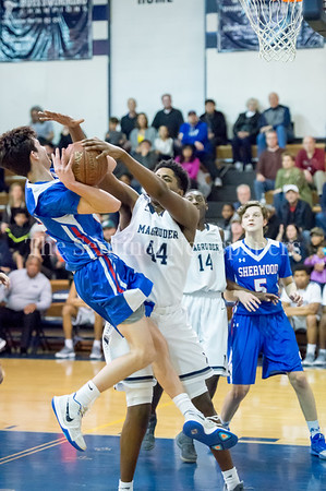 2/9/2018 - Sherwood senior guard Brad Riley (2) is fouled by Magruder junior forward Jordan Blackwell (44), Sherwood v Magruder Boys Basketball, ©2018 Jacqui South Photography