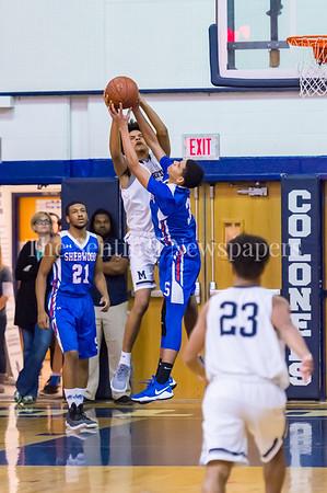 2/9/2018 - Magruder senior forward Josh Seymour (4) and Sherwood junior guard JD Jordan (3) fight for a rebound, Sherwood v Magruder Boys Basketball, ©2018 Jacqui South Photography