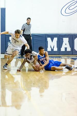 2/9/2018 - Sherwood senior Khari Johnson (21)  & Magruder freshman guard Michael Myrie (10) go for a loose ball, Sherwood v Magruder Boys Basketball, ©2018 Jacqui South Photography