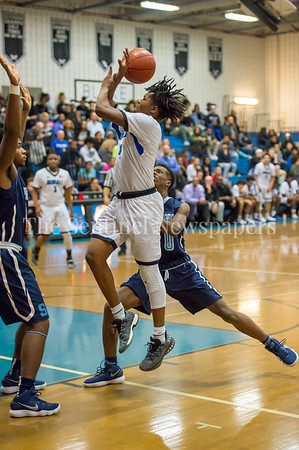 2/16/2018 - Blake senior guard Phillip Ellis (4) has the ball stripped by defender Delaino Jessup (10), Springbrook v Blake Boys Basketball, ©2018 Jacqui South Photography