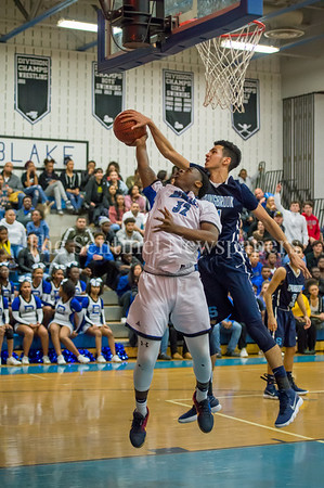 2/16/2018 - Cameron Rucker cleanly blocks this shot by Malik Raheem (32), Springbrook v Blake Boys Basketball, ©2018 Jacqui South Photography